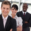 Young businessman leading a business team in a line — Stock Photo #10310279