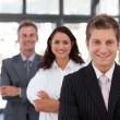 Charming businessman leading a business team in a line — Stock Photo #10310282
