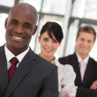 Young Afro-American businessman leading his team — Stock Photo
