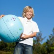 Cute boy playing with a terrestrial globe — Stock Photo