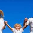 Cute family jumping in the air — Stock Photo #10310441