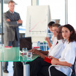 Mature manager in a presentation with folded arms — Stock Photo