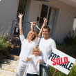Stock Photo: A family buying a house
