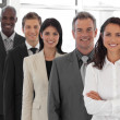 Businesspeople from different cultures looking at camera - Stock Photo