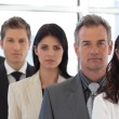 Multi Ethnic Business group looking at Camera - Stock Photo