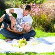 Стоковое фото: Father and son enjoying picnic
