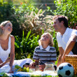 Happy family enjoying the sun in a picnic - Stock Photo