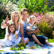 Happy family having a picnic with thumbs up — Stock Photo