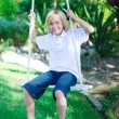 Child playing with a swing — Stock Photo