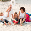 Stock Photo: Family playing with the sand
