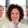 Smiling businesswoman with folded arms in office — Stockfoto