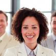 Smiling businesswoman with folded arms in office — Foto de Stock