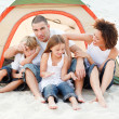 Happy family camping on beach — Stock Photo
