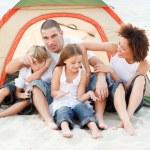 Happy family camping on beach — Stock Photo #10310868