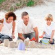 Family playing with the sand — Stock Photo