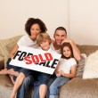 Royalty-Free Stock Photo: Happy family sitting on a sofa