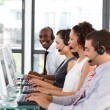 Smiling African-American businessman in a call center — Stock Photo