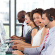 Ethnic businesswoman working in a call center — Stock Photo