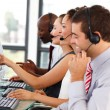 Attractive businessman working in a call center — Stock Photo #10310929