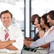 Senior leadership with folded arms in a call center - Stock Photo