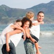 Stock Photo: Happy family playing on the beach