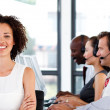 Happy female manager working in a call center — Stock Photo