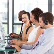 Stock Photo: Beautiful young businesswomin call center