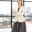 Beautiful businesswoman with folded arms — Stock Photo