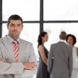 Young businessman being Positive with team in Background — Stock Photo #10311103