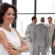 Attractive businesswoman  in office with her team — Stock Photo