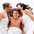 Couple and son lying in bed - Foto de Stock  