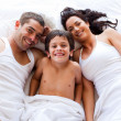 Family playing lying his son in bed - Foto de Stock  