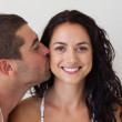 Portrait of an affectionate man kissing his wife — Stock Photo