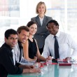Royalty-Free Stock Photo: Business team smiling at the camera in office