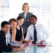 Female manager with her team looking at the camera — Stock Photo