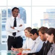 Afro-American manager with folded arms working with his team — Stock Photo
