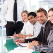 Business team working and smiling at the camera — Stock Photo