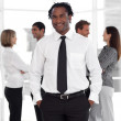 Business ethnic leader with his team — Stock Photo