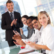 Royalty-Free Stock Photo: International business team clapping at the end of a presentatio