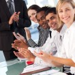 Business team applauding in meeting — Stock Photo #10311376