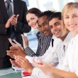 Stock Photo: Business team clapping in a meeting