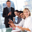 Business team applauding in meeting — Stock Photo #10311385