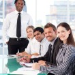 Stock Photo: Happy business leader with his team in a meeting