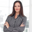 Young businesswoman with folded arms — Stock Photo