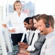 Female leader managing her team in a call center — Stock Photo