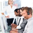 Royalty-Free Stock Photo: Female leader managing her team in a call center