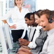 Concentrated female leader with a team on a call center — Stock Photo