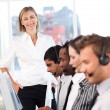 Royalty-Free Stock Photo: Concentrated female leader with a team on a call center