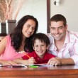 Royalty-Free Stock Photo: Lovely couple helping his son for homework