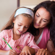 Happy mother helping her daughter for homework — Foto de Stock